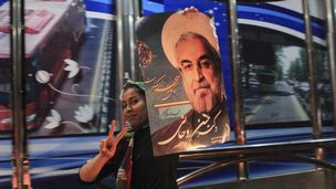 "A supporter of moderate cleric Hassan Rohani celebrates his victory in Iran""s presidential election"