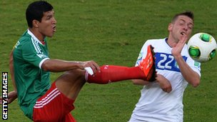 Mexico's Francisco Rodriguez (left) and Italy midfielder Emanuele Giaccherini
