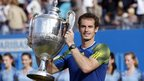 Andy Murray lifts the trophy after winning the Aegon Championships at the Queen's club in London.