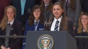 The president is introduced by 16-year-old Methody student, Hannah Nelson