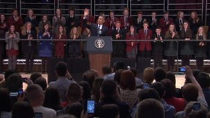President Barack Obama takes to the stage, with the crowd taking to their feet to welcome him