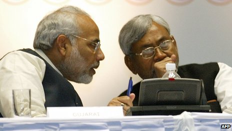 In this photograph taken on January 6, 2006, India's Gujarat state Chief Minister Narender Modi (L) talks with Bihar state Chief Minister and senior Janata Dal United (JDU) leader, Nitish Kumar, during a conference in Hyderabad