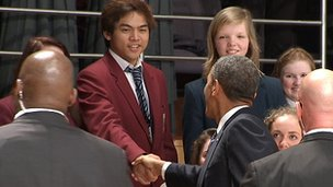 After his speech, the president shook hands with local students