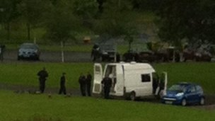 Police dogs in Enniskillen at the G8 venue making it difficult for BBC's Mark Devenport to hear President Obama