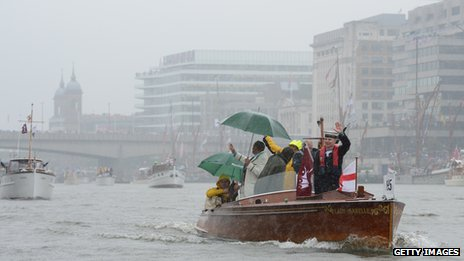 Rain-soaked Thames river pageant