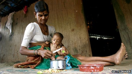 An Indian woman cares for her malnourished grandchild