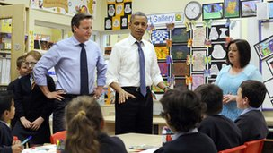 The two leaders helped pupils at Enniskillen Integrated Primary School paint a G8 banner