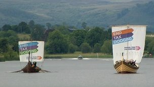 Protestors take to Lough Erne to highlight their campaign against global policies linked to the G8