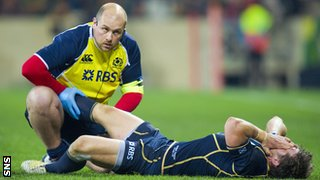 Scotland's Peter Horne receives treatment