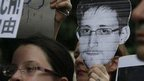 Supporters hold a picture of Edward Snowden, a former CIA employee who leaked top-secret information about U.S. surveillance programs during a protest outside the Consulate General of the United States in Hong Kong 15 June 2013
