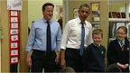 David Cameron and Barack Obama in classroom with children