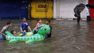 Children in India on inflatable float in India.