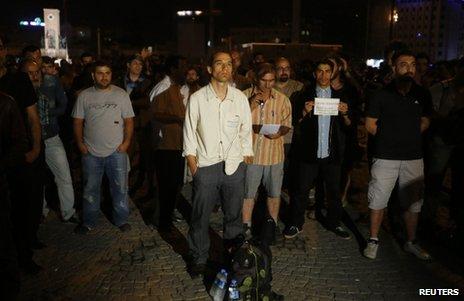 Erdem Gunduz (C) stands in a silent protest on Taksim Square in Istanbul, early on 18 June