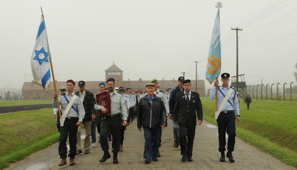Israeli forces march out Auschwitz, holding aloft the Star of David