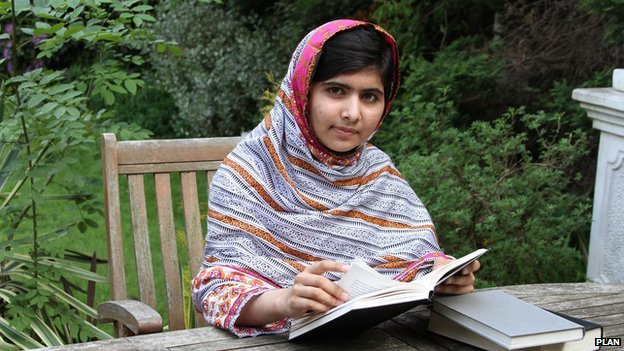 Malala Yousafzai at home reading a book in her garden