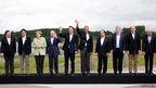 G-8 leaders pose during a group photo opportunity at the Lough Erne golf resort in Enniskillen, Northern Ireland