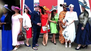 Andrew Fisher of Fishhead Hats in London at Royal Ascot with women modelling his hat designs