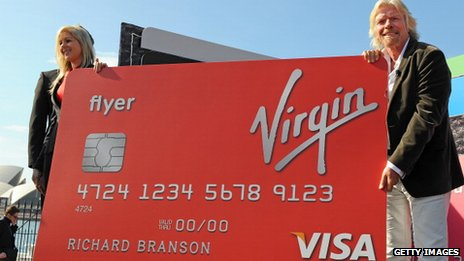 Richard Branson holding large Virgin Money credit card