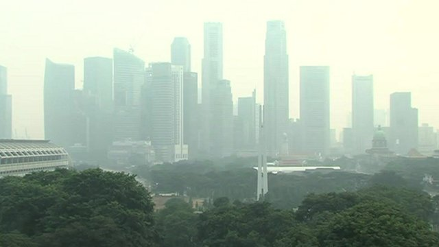 Wood-smoke cloud hangs over Singapore