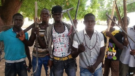 Vigilantes youths pose for a photographs in Maiduguri, Nigeria. 11 June 2013