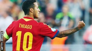 Thiago celebrates scoring for Spain