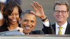 US President Obama waves after arriving in Berlin. Photo: 18 June 2013
