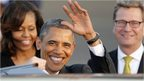 US President Obama waves after arriving in Berlin