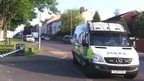 Police vehicle near murder scene in Pitsmoor