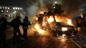 Firefighters try to extuinguish a burning van in Sao nPaulo on 18 June 2013