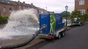 Aerators pumping oxygen into a canal in Kidderminster after a fire