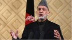 Afghan President Hamid Karzai speaks during a ceremony to mark the 80th anniversary of Kabul University in Kabul May