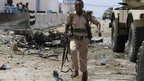 A Somali government soldier runs to take cover during crossfire after gunmen attacked a United Nations compound in the Somali capital Mogadishu, 19 June  2013