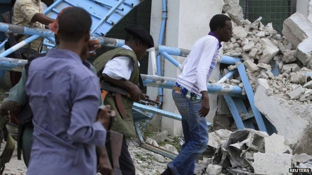 Somali government soldiers pictured after a suicide bomb attack inside the United Nations compound in the Somali capital Mogadishu 19 June 2013