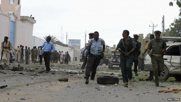 Government soldiers arrive to secure the United Nations compound following a suicide bomb attack in the capital Mogadishu, 19 June 2013