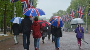 People walking in the rain with umbrellas.