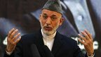 Afghan President Hamid Karzai speaks during a news conference, 18 June