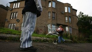 Children playing football in Glasgow street