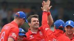 James Anderson celebrates with his England team mates