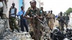 A Somali government soldier at the scene of the attack in Mogadishu. Photo: 19 June 2013