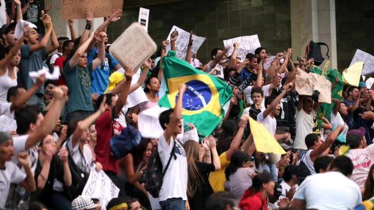 "People shout slogans during a demonstration against the $15 billion being spent on this month""s Confederations Cup in Belo Horizonte"