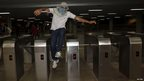 Protester jumps over a turnstile during public transport protest, Brasilia (19 June)