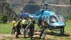 Members of the Indian Army evacuate an injured person during a search and rescue operation in the Chamoli district in the northern Uttarakhand state on June 19, 2013.