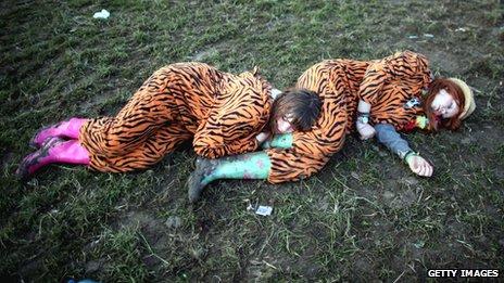 Festival goers in onesies