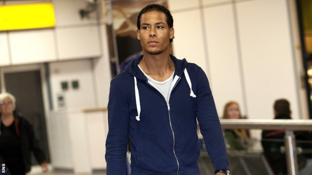 Virgil van Dijk arrives at Glasgow Airport