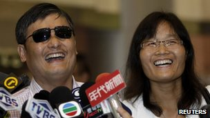 Chinese dissident Chen Guangcheng (L) and his wife Yuan Weijing answer questions from reporters while arriving at the Taoyuan International Airport, northern Taiwan, 23 June 2013