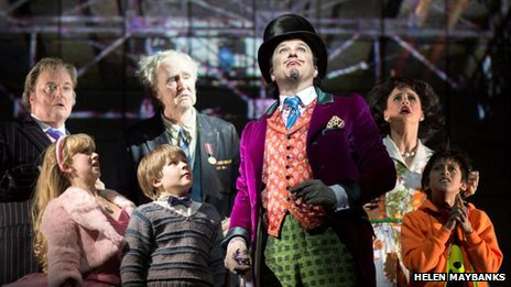 Douglas Hodge as Willy Wonka with Jack Costello as Charlie and cast members. Photo by Helen Maybanks