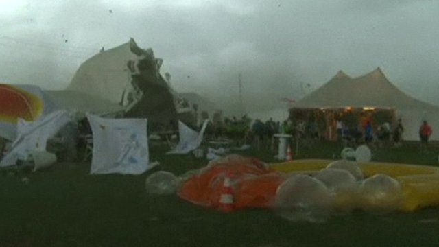 Tent being lifted from the ground by strong winds