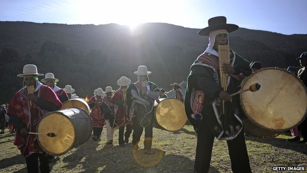 Aymara natives arrive to Khona bay for summer solstice celebrations on Isla del Sol, Lake Titicaca, Bolivia
