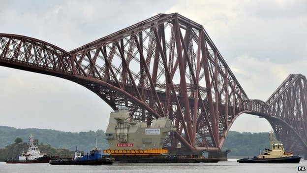 Piece of HMS Queen Elizabeth passes under Forth Bridge