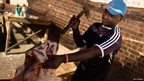 A butcher at South Africa's Farady Market - Tuesday 18 June 2013